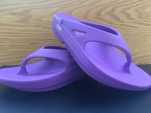 Stay away from flat sandals and get yourself a pair of Oofos for shock absorption and support